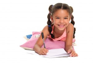 young girl working on homework against a white background